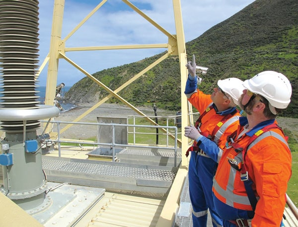 Asset Development Engineering Manager, Andrew Renton (left) and Maintenance Engineer, Peter Wiseman, examine roof bushing at Oteranga Bay Cable Termination Cable Termination Station Fights Ongoing Battle Against Pollution Pic182