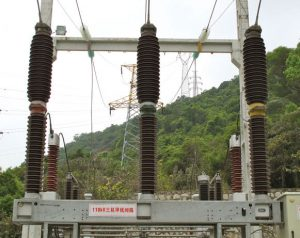Breaker housings at left were not well specified for service at a 110 kV substation near seacoast and subsequently had to be coated with RTV to prevent flashover. Newer breakers at same substation (top) feature porcelain housings with alternating sheds and higher specific creepage and do not have coatings. pollution monitoring Pollution Monitoring Principles for Better Selection of Insulators in Contaminated Service Conditions (Part 2 of 2) p3 300x238