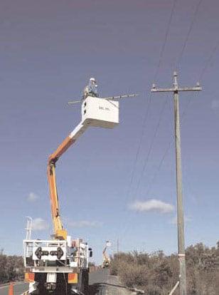 22-kV-porcelain-insulators-on-burnt-cross insulator Australian Utility Confronted Insulator Pollution 22 kV porcelain insulators on burnt cross