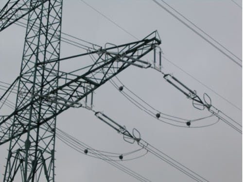 Fig. 2: 400 kV line with insulator strings modified into 'upturned T'. insulator string Transmission Utility Re-Designed Insulator Strings to  Upgrade Thermal Rating of Lines 400 kV line with insulator
