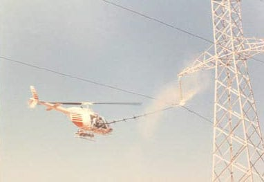 Washing-of-HV-line-by-helicopter insulator Australian Utility Confronted Insulator Pollution Washing of HV line by helicopter