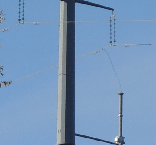 Fig. 19: Installation of bottom-phase arrester supported from below in Alberta, Canada. vibration damper Interaction of Line Surge Arresters with Vibration Dampers Screen Shot 2016 04 01 at 1