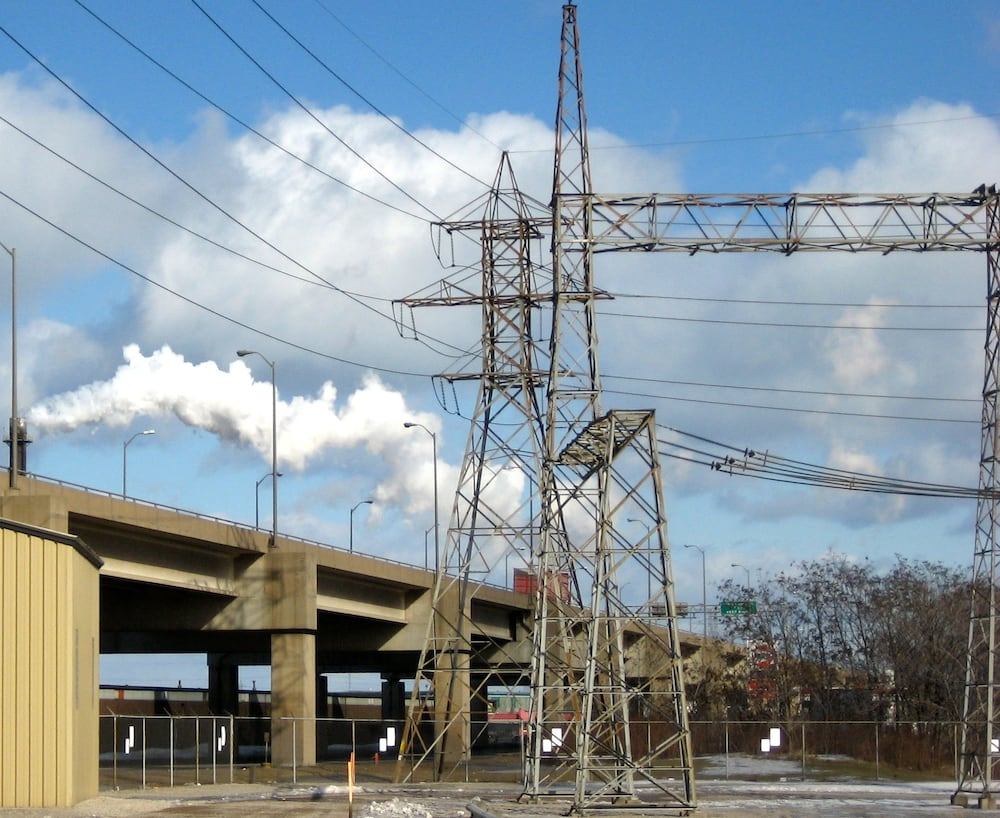 Smokestack next to Hamilton Beach Station belong to factory producing carbon black. Highway overpass adjacent to substation is a source of salt pollution during wintertime. substation Program of Pollution Countermeasures Paid Off at Key Transmission Substation inmr