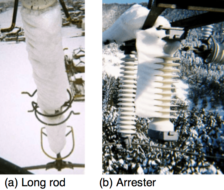 Fig. 1b: Example of packed snow on vertically mounted long rod insulator strings and gap type arresters. Insulator String Widespread Blackout Triggered  Study of Contaminated Snow on Insulator Strings Screen Shot 2018 10 14 at 13