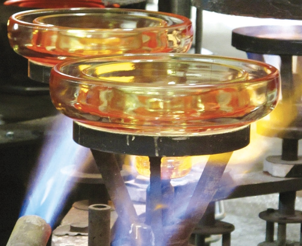 Glass shells are toughened by process of forced cooling that imparts desired compressive stresses at surfaces. Process to create glass insulators Glass Insulator Manufacturing Glass Insulators Glass shells are toughened by process of forced cooling that imparts desired compressive stresses at surfaces