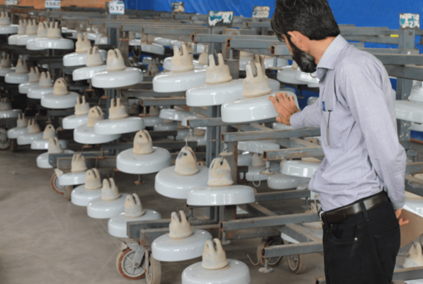Expanding Grid in Pakistan Confronts Challenges of Pollution, Icing & Lightning (Part 1 of 2) Insulators removed from lines are cleaned and readied for coating with RTV silicone material 1