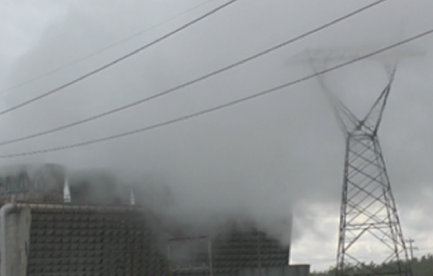 Transmission tower surrounded by vapor