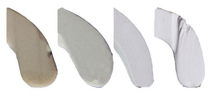 Illustration of large differences in body color among porcelain insulators evaluated. From left to right: Insulator I (yellowish tinge), Insulator G (pale white), Insulator K (grayish tinge), Insulator A (bright white).