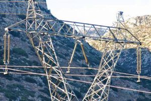 Line in heavily polluted northeast Crete insulated with silicone insulators. Note that one unit installed on middle phase has blackened near live end at time of photo (2008). test station Expanded Test Station Helps Greek Power System Operator Assess Insulator Design & Performance Topic 1 Apr 6 line in 300x200