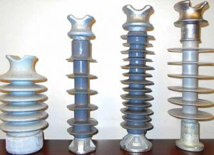 Vertical F neck comparison. (Left to right): 35 kV porcelain, 35 kV polymer, two designs of 45 kV polymers. distribution systems,pollution & wildlife, porcelain, insulators,insulator, power, distribution, contamination Resolving Problems on Distribution Systems from Pollution & Wildlife Topic 1 July 20 verti 300x218