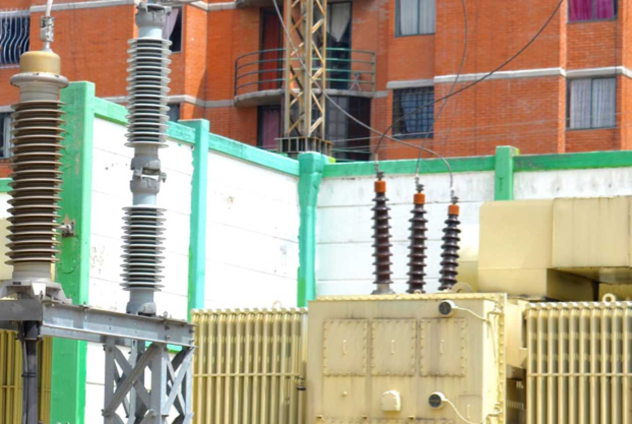 Bushing Technology Review: Designs & Tendencies Oil filled bushings in service in Mexico City substation only meters from residential high rise