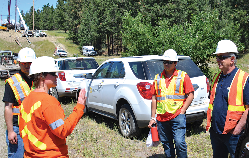 FortisBC engineers discuss installation with Operations Manager, Tom Harrison (right). transmission poles Canadian Utility's Trial Evaluation of Composite Transmission Poles Screen Shot 2017 09 15 at 11