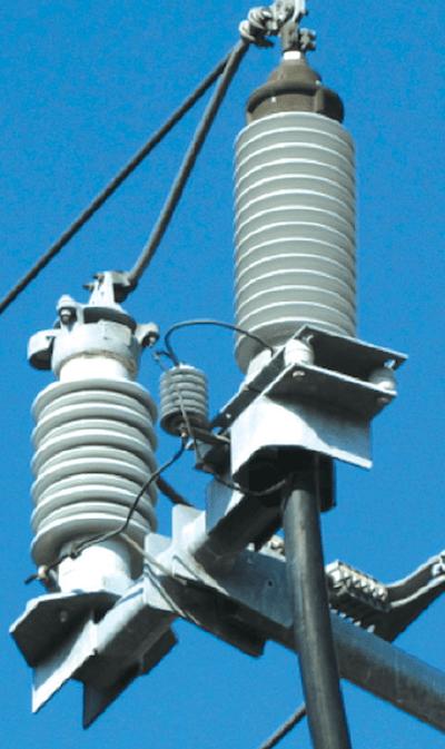 arrester Technology & Application Review of Arresters that Extend Life of Cables Transmission line riser pole arrester left and SVL center