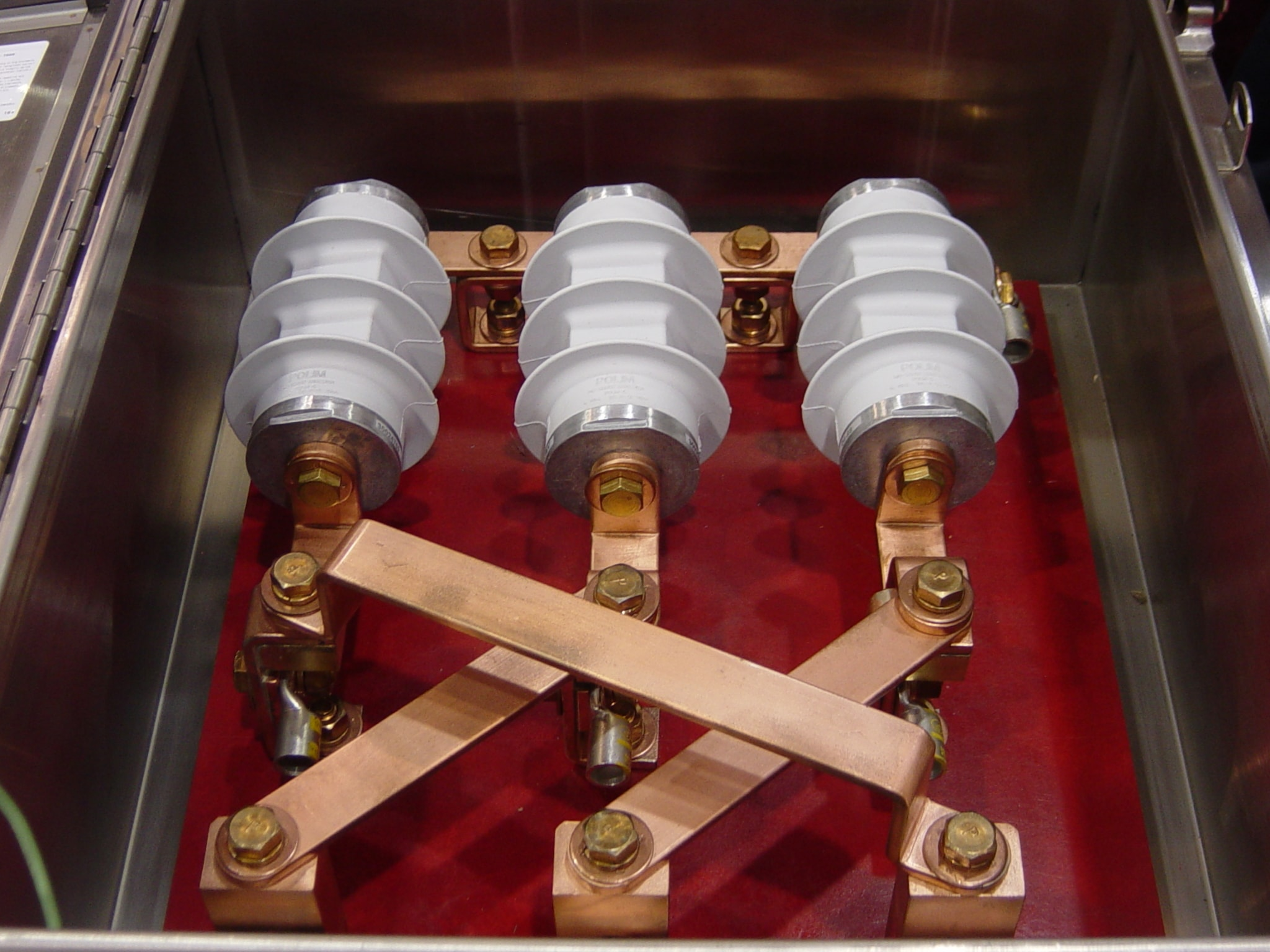 Fig. 4: Link box with 3 SVLs and cross-bonded sheaths. power cables Sheath Voltage Limiters Protect HV Power Cables Figure 4 Cross Link Box SVL Arresters