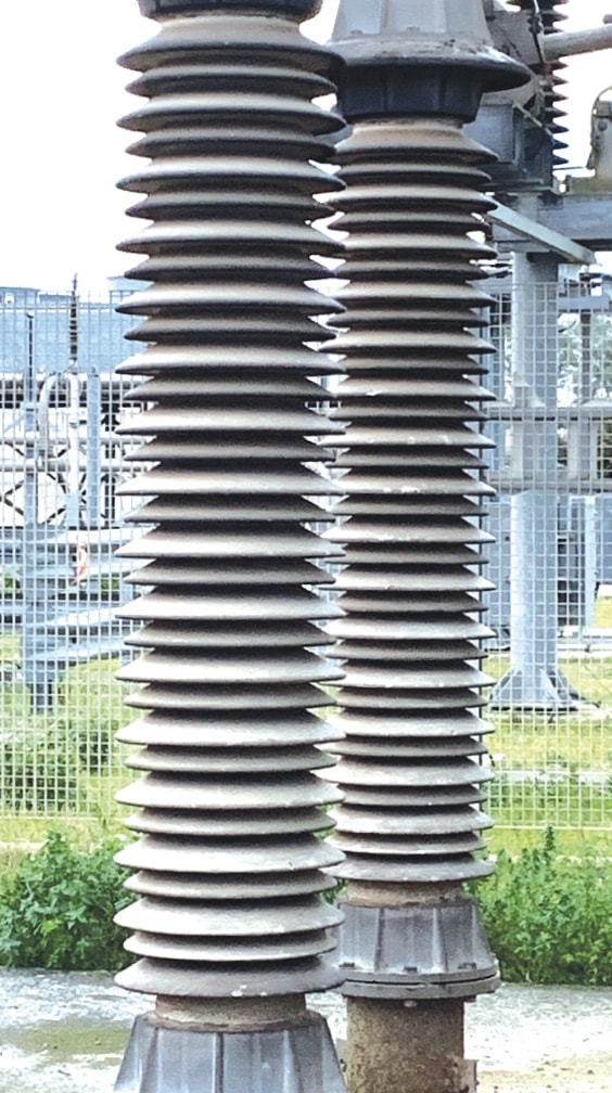 substation insulator Achieving Confidence  in Line & Substation Insulators Detail of part of six post insulators with in field RTV coating supporting the DC smoothing reactor in Galatina on Italy     Greece HVDC Intertie