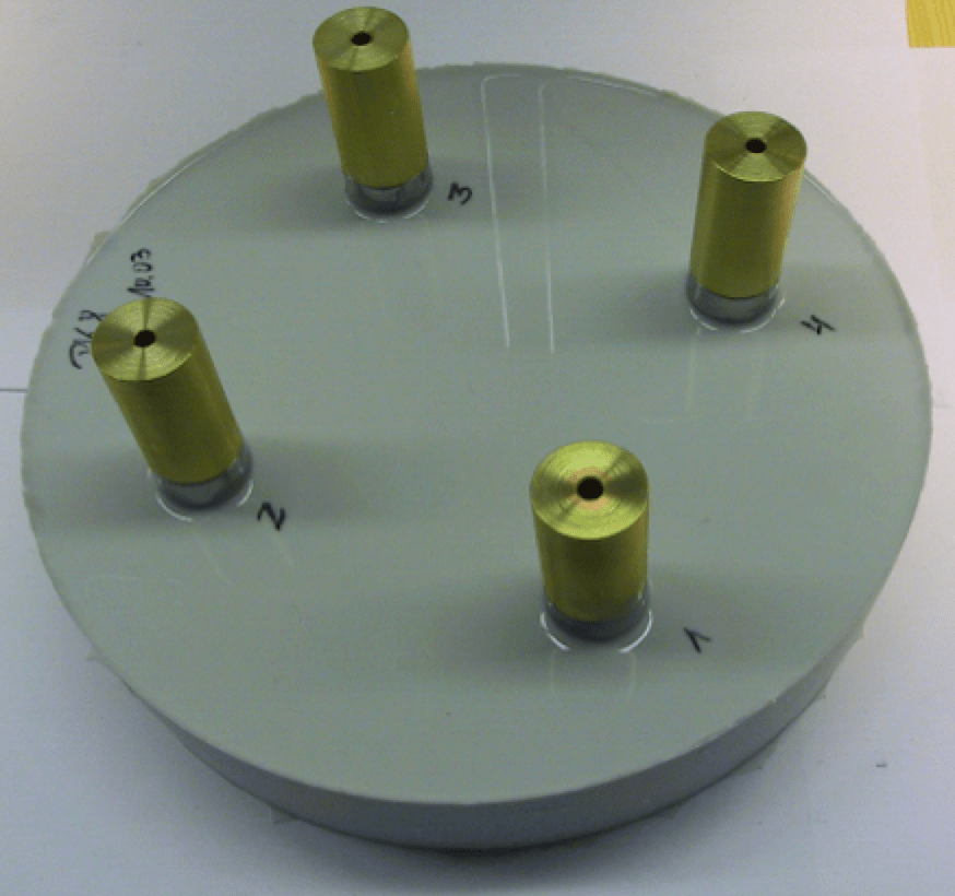 Fig. 15: Electrodes, ball shaped at bottom, measure specific break-down voltage embedded in soft silicone elastomer. cable accessories Silicone Elastomers, Gels & Auxiliary Materials for Cable Accessories Electrodes ball shaped at bottom measure specific break down voltage embedded in soft silicone elastomer