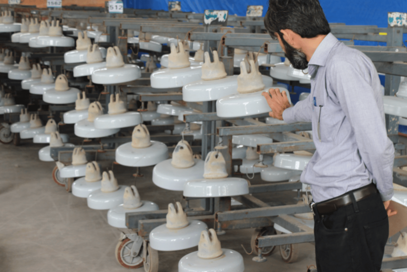 Transmission Grid in Pakistan Confronts Dual Challenges of Pollution & Icing (Part 1 of 2) Insulators removed from lines are cleaned and readied for coating with RTV silicone material