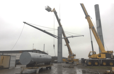 Evaluating Transmission Structures for Reduced Cost & Greater Public Acceptance Erecting test tower