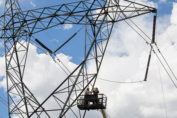 Linemen installing NGLA